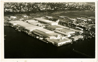 Aerial of Bellingham Cold Storage with railroads and neighborhoods in background