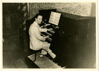 Gunnar Anderson seated at an organ