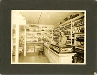 Roseberg, Oregon store - interior of mercantile with Dayton P. Weaver behind counter
