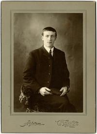 Man in suit poses for studio portrait