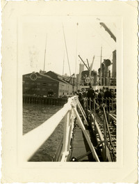 View from railing on deck of ship as it pulls into Pier One at Seattle, WA