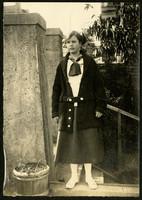 Teenage girl in scarf and cardigan