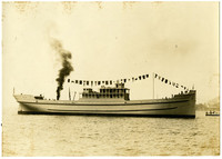 Unidentified steam ship with tug behind it