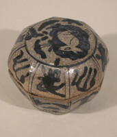 Octagonal lidded box with blue decoration of symbols, clouds, and rabbit on lid