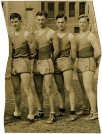 Four young men pose in track and field uniform of Fairhaven High School