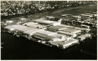 Postcard of aerial view of Bellingham Cold Storage with railroads and neighborhoods in background
