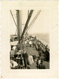 Getting Home Day, 1939, aboard P.A.F. boat M.S. Cleveden. Men mill around deck of sailing vessel at sea
