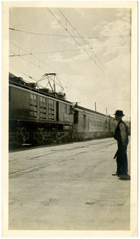Man looks at row of rail cars at Elks Convention in Butte, Montana