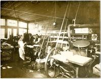 Three men at early print shop