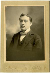 C.K. McMillin/E.D. McMillin - Man in suit poses for studio portrait