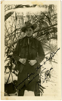 Young man stands wearing Ranger or Mounty-type uniform stands in snowy woods