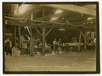Several workers pose at their work stations in the box department of Pacific American Fisheries in Bellingham, WA