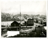 Rooftop view of early Fairhaven, Wa, from lower Harris avenue looking east with tower of Fairhaven Hotel in distance