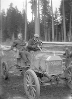 Two men seated in stripped-down automobile (possibly Mount Baker Marathon contestants)