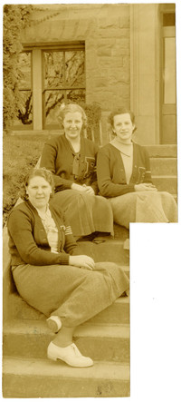 Three Fairhaven High School school girls in letter jackets pose on steps