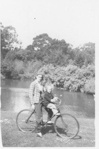 Woman and child on bicycle