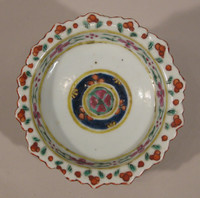 Bencharong footed dish, exterior with rust, pink, yellow floral panels, interior with floral devices