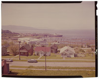 View from 12th street, Fairhaven, Bellingham, WA, towards Bellingham Bay and Pacific American Fisheries facilities where a ship is docked