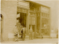 Roland Gamwell, T.W. Gillette and Charles Reaves stand in front of Great Northern Express Company office