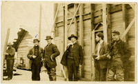 Six men standing outside King Cove warehouse
