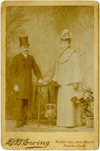 Studio portrait of standing man and woman