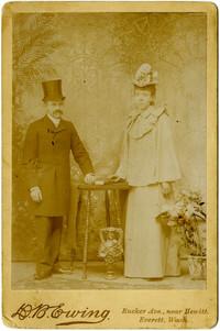 Studio portrait of standing man and woman