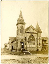 Exterior of ornate First Baptist Church with front rosette window, Bellingham, Washington