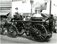 Bellingham Fire Department - antique fire engine is pulled by horses in a parade