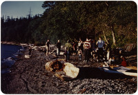Group of people gathered on beach for picnic