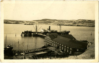 Large cannery freight ship docked at Pacific American Fisheries cannery, Alaska