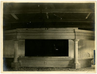 A post, pier, and cornice assembly under construction in warehouse