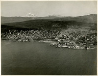 A view of Fairhaven (Bellingham), Washington, from Pacific American Fisheries on waterfront towards Mt. Baker