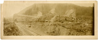 Unidentified mining operation with railroad tracks in the foreground