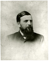 Studio portrait of C.X. Larrabee