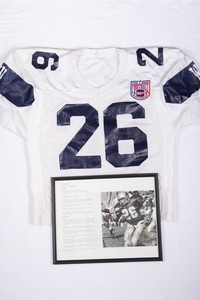 Footbal Jersey and Photograph: Photograph of Jon Brunaugh and Jersey #26 , note listing honors and records, 1992/1995