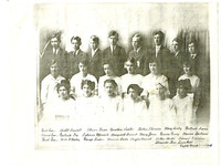 Class portrait of the 1915 8th grade class at Assumption Catholic School with girls in white, boys in suits