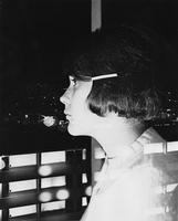 1965 Student looking at Higginson Hall