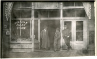 Three men stand outside Kulshan Cigar Store