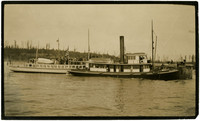 """Pacific American Fisheries """"Calendar"""" vessel and another vessel docked with a crowd of people waiting to board"""