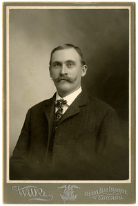 Studio portrait of unidentified man in suit with moustache