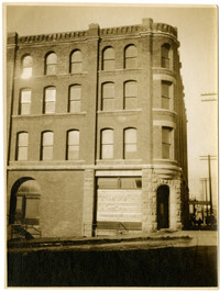 Exterior of the R.V. Palmerton Hay, Feed, and Seed Company's four-story brick Waldron Block building in Fairhaven, Bellingham, WA