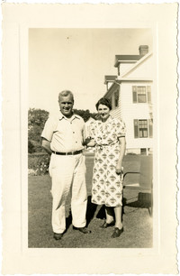 Man and Woman pose together in yard