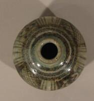 Sawankhalok ware jar with globular body, iron black design of panels of scrolls and hatching