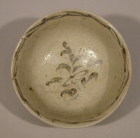 Bowl with iron black design of floral spray in interior