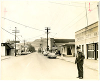 Looking down Main Street in Everson, Washington, with Mayor Joe Anderson standing in street in front of City Hall