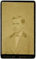 Formal studio portrait of unidentified teenage boy