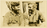 Two men seated on deck of ship