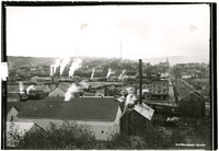 View of rooftops of Fairhaven, Washington, with smokestacks