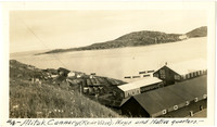 Alitak cannery buildings at shoreline with island in distance