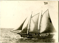 """""""Blanket Bill"""" Jarman's four-masted schooner with American flag on the water"""